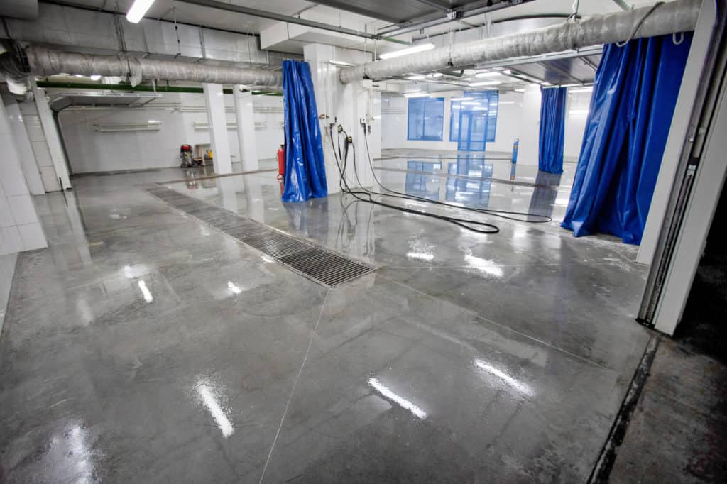 Newly installed reflactive coating on a car washing interior floor