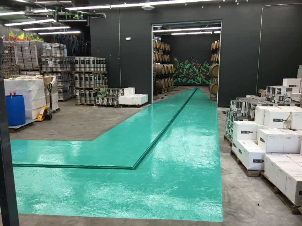 Beautiful green epoxy coated floor of a industrial storage space