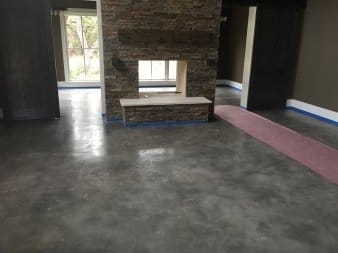 Modern stained epoxy coated floor on a concrete floor of a residential house