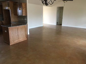 Solid brown stained epoxy coated on a concrete floor, San Antonio