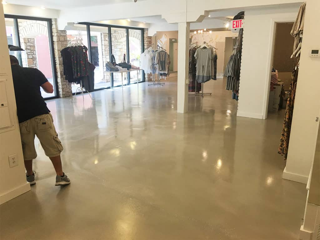 Solid shiny epoxy coated in a commercial retail store floor