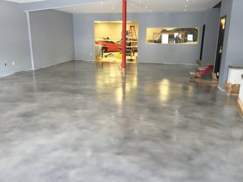 Solid stained epoxy installed for concrete showroom garage floor