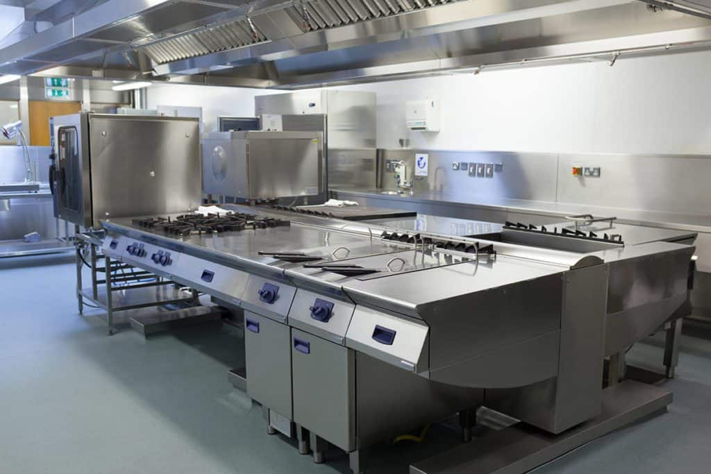 Solid gray epoxy coated floor of a big commercial kitchen