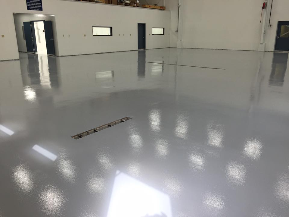 White reflactive epoxy coated floor of a airplane hangar space