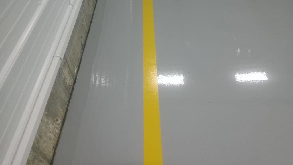 Yeloow stripe marks for car parking space of a commecial garage