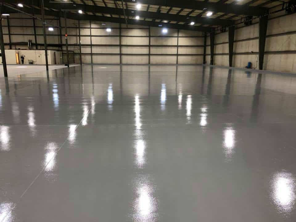 Big garage looking really good after installing solid white epoxy on its floor