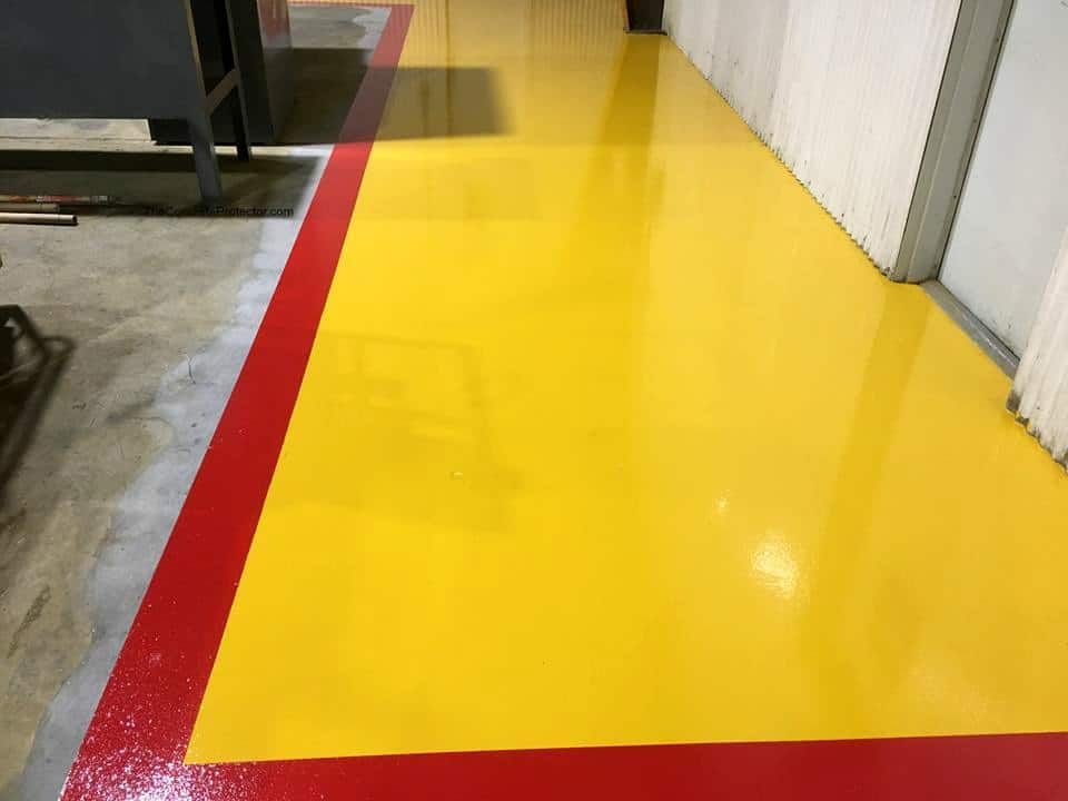 Yellow and red striped floor epoxy coated in a industrial space