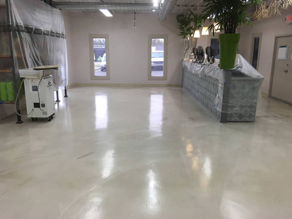 Reflactive epoxy caoted square floor of a retail shop