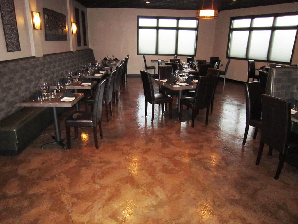 Beautiful red stained epoxy coating floor of a restaurant interior