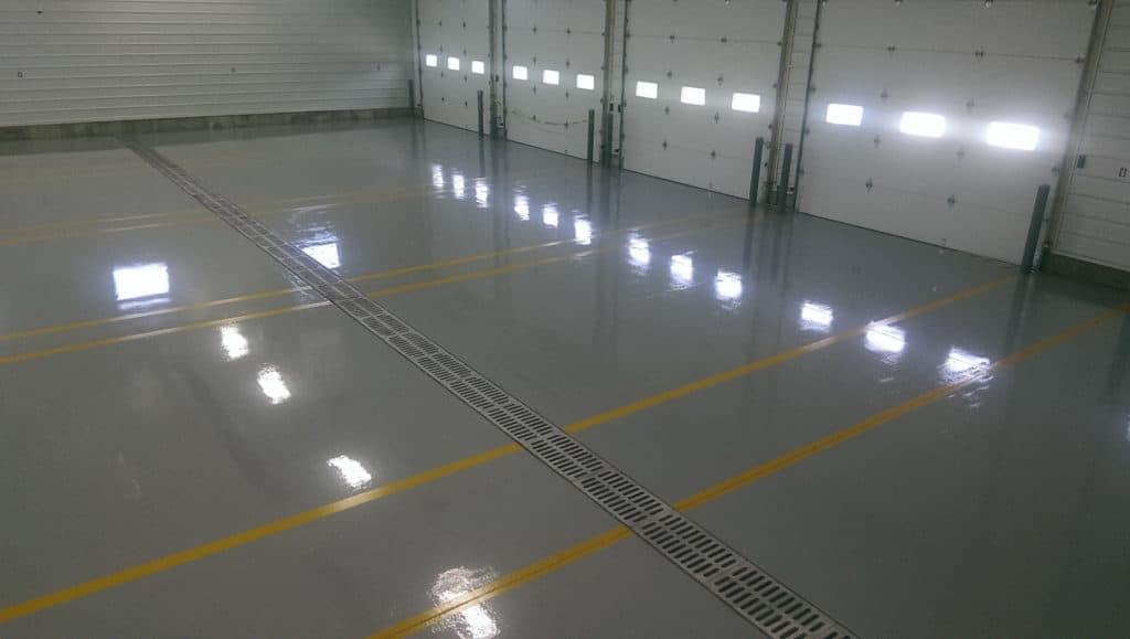 Yellow striped reflactive garage floor of a big commercial space