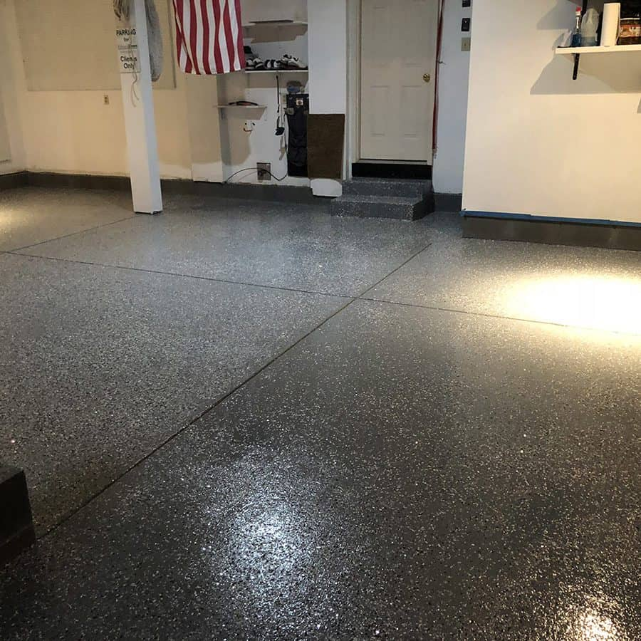 Black chip epoxy flooring design of a garage