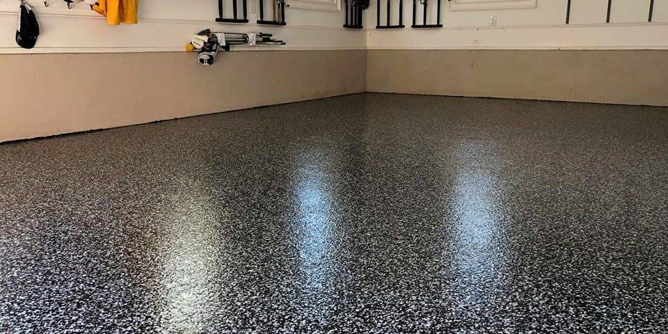 black chip epoxy flooring installed in a residential house