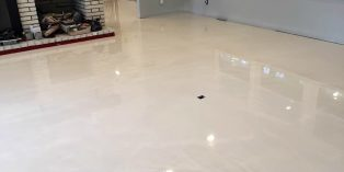 Shiny and reflactive white epoxy coated floor of a residential house